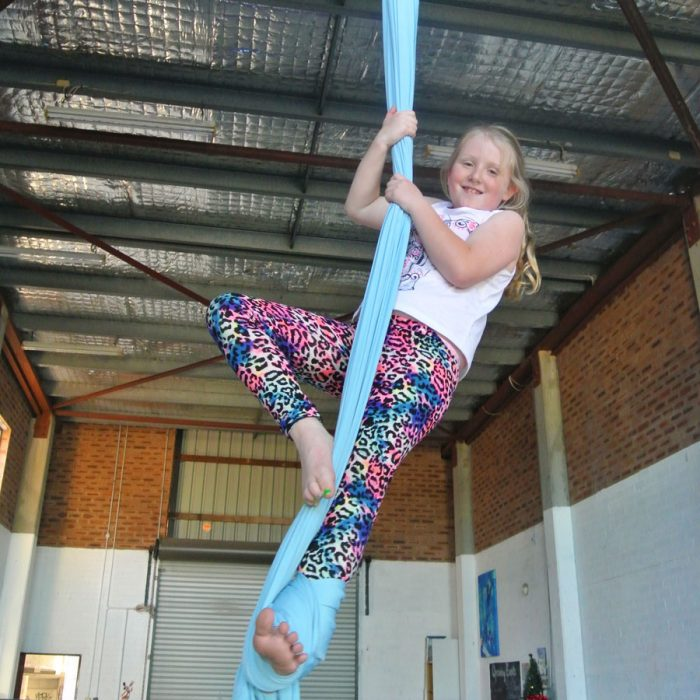 Learning silks at circus class