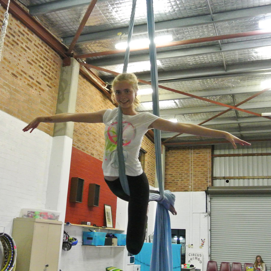 Teenager Amy on the aerial silks (also known as tissu)