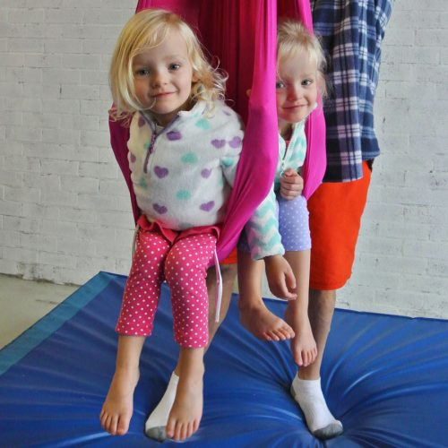 Jugglebugs playgroup students on the aerial sling