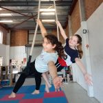 Newfound friends learning new skills on the double trapeze