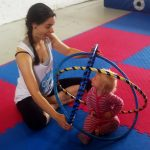 Jugglebugs playgroup student and trainer creating a hula hoop sculpture